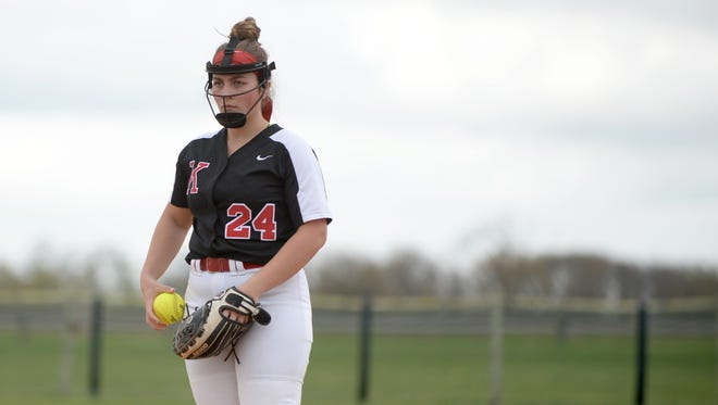 Kingsway senior pitcher Danielle Dominik looks for the signal from her catcher in an April win over Clearview. Dominik is one of 25 first-team All-South Jersey players.