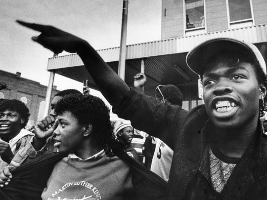 """Joey Harney, 18, right, of Pulaski, chants """"King...King...King..."""" as he and others follow the march staged by the Klan to protest designating Martin Luther King Jr.'s birthday a holiday in downtown Pulaski Jan. 25, 1985."""