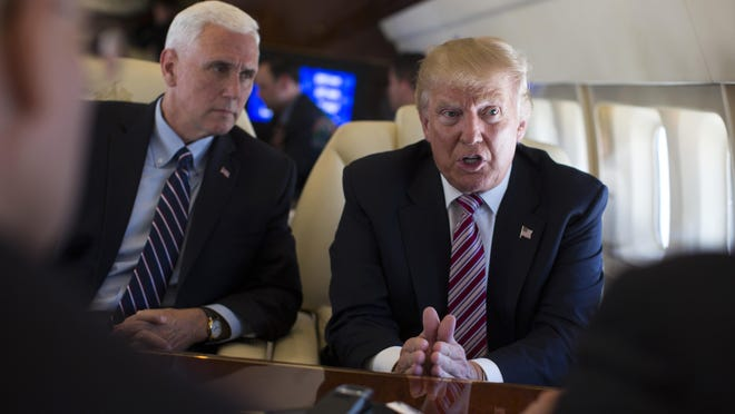Gov. Mike Pence, left, has been by Donald Trump's side since joining the campaign as a vice presidential candidate.