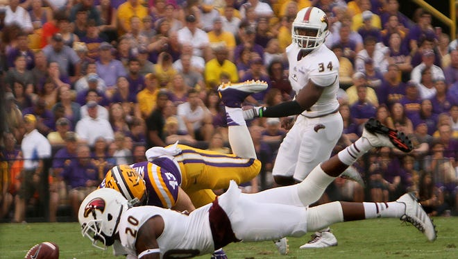 University of Louisiana at Monroe's Justin Backus (20) falls after missing a tipped ball during a first quarter play against the Louisiana State University Saturday, Sept. 13, 2014, at Tiger Stadium in Baton Rouge, La.