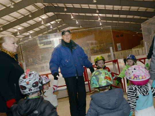 Bob Mock, 64, works with a class of young skaters on