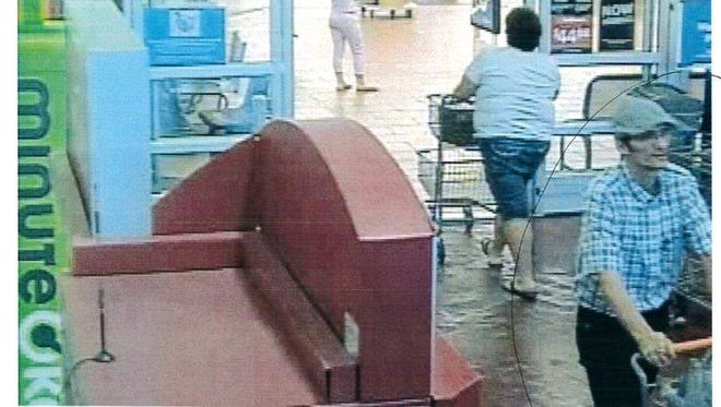 One of the suspects in a possible bottle return fraud ring is seen in the lower right corner of a surveillance photo.