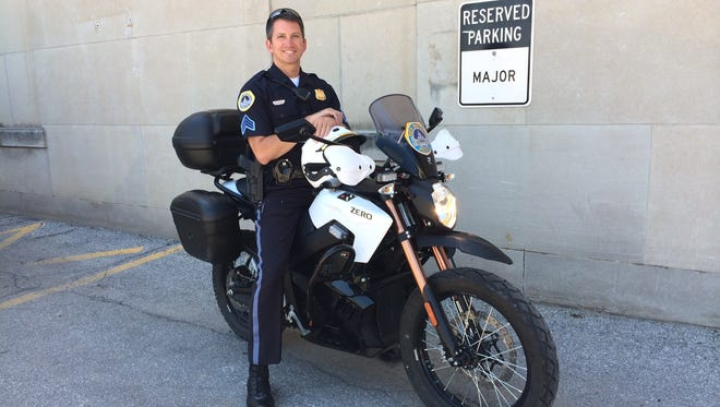 Sgt. Paul Parizek shows off a potential purchase for the police department.