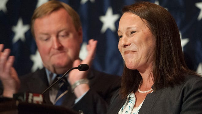 U.S. Rep. Martha Roby, R-Montgomery talks to supporters after winning the primary run off election Tuesday, July 17, 2018, in Montgomery, Ala. Her husband Riley is pictured at left.