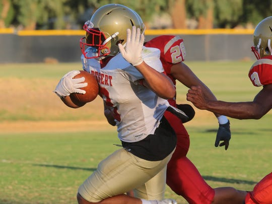 Tony Williams carries the ball during practice with College of the Desert, August 29, 2017.