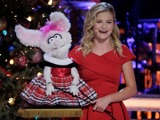 "Darci Lynne, left, and her bunny puppet, Petunia, in ""My Hometown Christmas."""