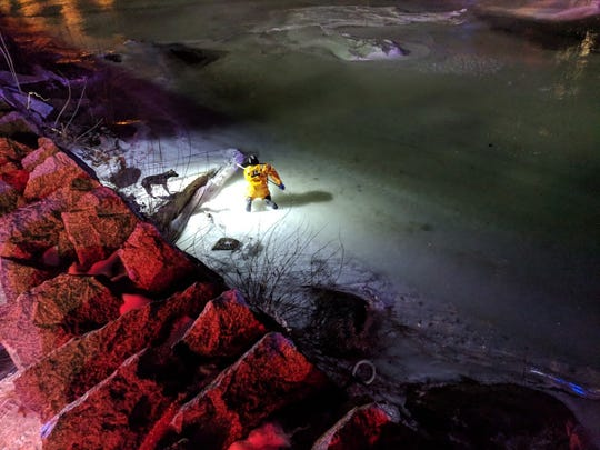 Wilmington firefighters and other emergency personnel rescued a man and his dog from Brandywine River Sunday night.