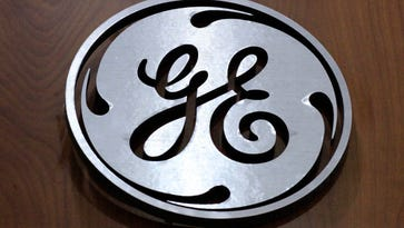 General Electric profit falls, missing expectations, will cut $20 billion in businesses