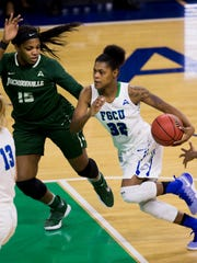 FGCU's Rosemarie Julien (32) drives the ball in the first half of action during the semifinal game of the Atlantic Sun tournament at Alico Arena Wednesday, March 8, 2017 in Estero.