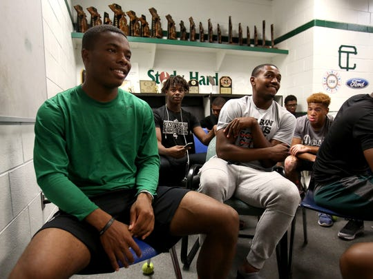 Cass Tech defensive back Kalon Gervin, left, and quarterback Aaron Jackson sit in the team meeting before looking over film at Cass Technical High School in Detroit, Aug. 18, 2017.
