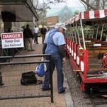 Engineer Michael Meredith walks past the Pierre Laclede on Friday, April 1, 2016, after two trains collided on The Emerson Zooline Railroad at the Discovery Corner Station at the Saint Louis Zoo.