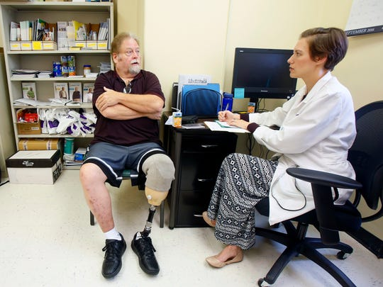 Calvin Wick meets with Clinical Pharmacist Cassy Hobbs,