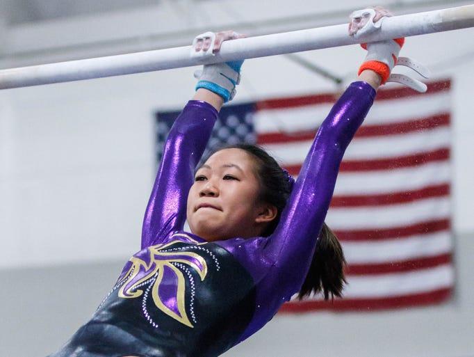 Oconomowoc gymnast Carli Christman competes on the