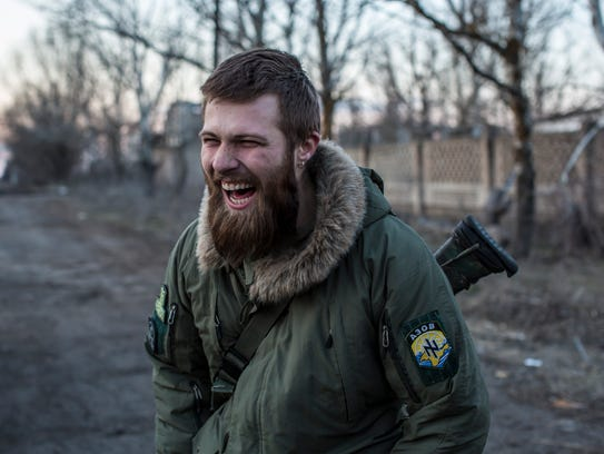 Alex, a drill sergeant with the Azov Brigade, supervises