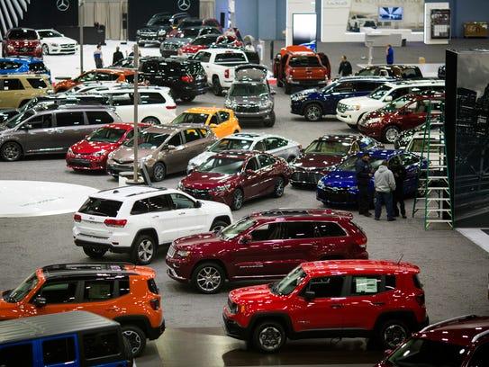 Cars park inside Duke Energy Convention Center for the Cincinnati Auto Expo Tuesday, February 16, 2016. The Expo opens Wednesday, February 7 and runs through Sunday, February 11, 2018.