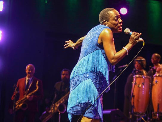 Sharon Jones performing with her band, the Dap-Kings,