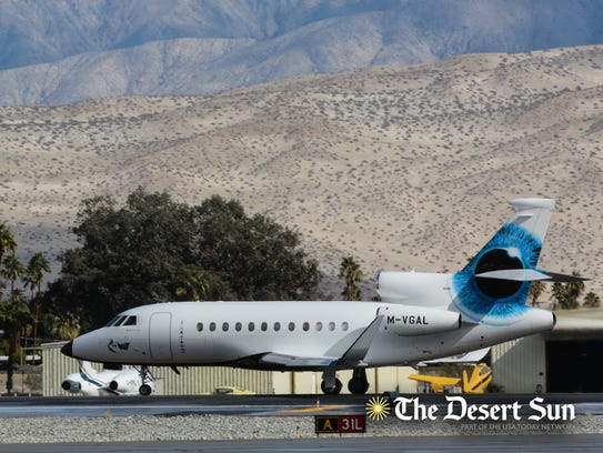 Michelle Obama boards a jet to fly out of Palm Springs