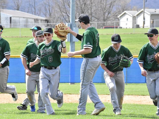 The James Buchanan baseball team celebrates after retiring
