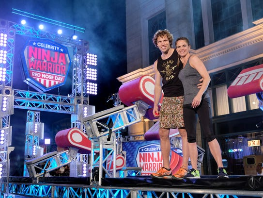 Grant McCartney and Natalie Morales pose together during