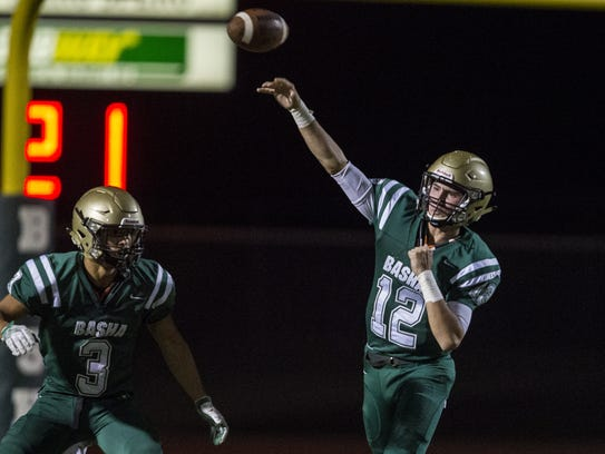 Basha's Connor Phelan passes against Brophy Prep during