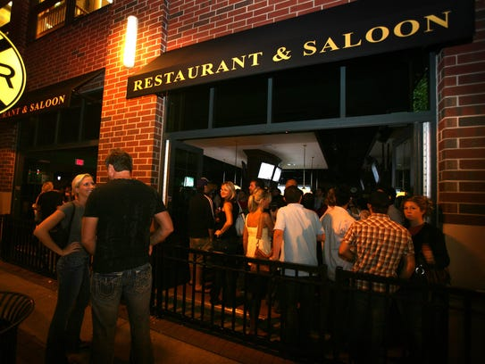 People spill out of the packed Blackfinn Restaurant