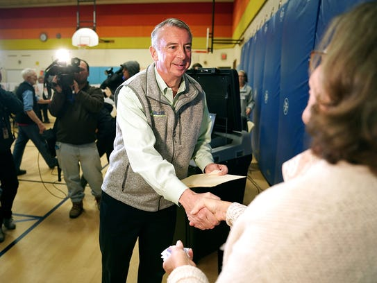 Ed Gillespie shakes hands with a poll worker after