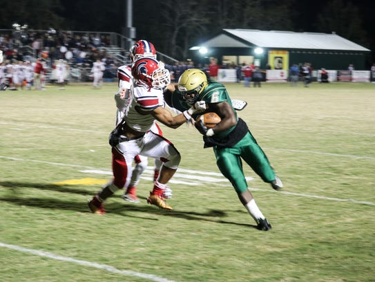 Acadiana High's Ziggy Francis (6) powers past the Comeaux