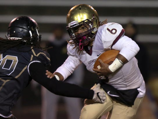 Lutheran's Andre Jones (6) leads the Saints into Class