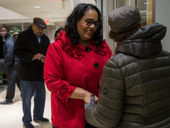 Renee Hardman, the first black woman elected to the West Des Moines City Council, greets friends and supporters who attended her swearing-in ceremony on Monday, Dec. 11, 2017, at the West Des Moines City Hall.