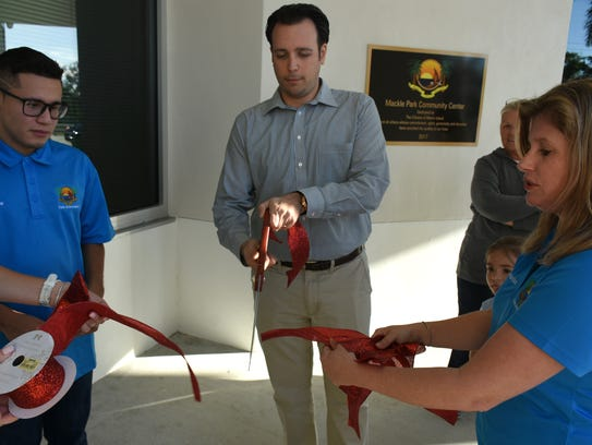 File: City Council Chairman Jared Grifoni cuts the ceremonial ribbon for the new Mackle Park Community Center.
