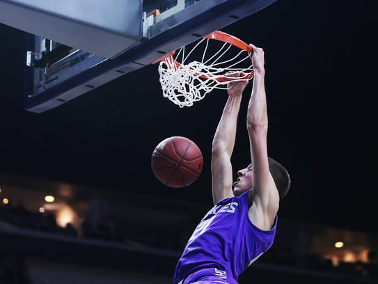 Muscatine's Joe Wieskamp dunks the ball during the