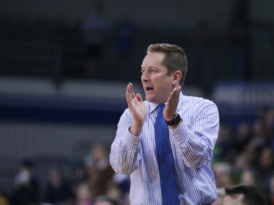 Drake coach Niko Medved calls out a play during the