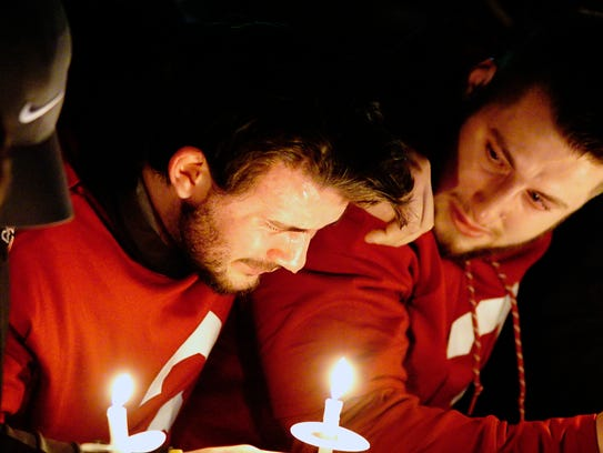 Former Washington State quarterback Luke Falk cries