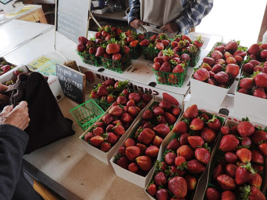 Organic strawberries are for sale at The Abundant Table
