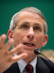 In this Oct. 16, 2014 file photo, Dr. Anthony Fauci, director of The National Institute of Allergy and Infectious Diseases, testifies before the The House Energy and Commerce Committee's subcommittee on Oversight and Investigations on Capitol Hill in Washington.