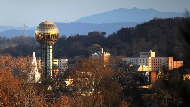 The Sunsphere, with Mount LeConte in the distance, is pictured Wednesday, Nov. 19, 2014. Fort Sanders Regional Medical Center is at right. (PAUL EFIRD/NEWS SENTINEL)