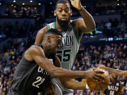 Brooklyn Nets guard Caris LeVert (22) drives against Boston Celtics center Greg Monroe (55) during the first half of an NBA basketball game Wednesday, April 11, 2018, in Boston. (AP Photo/Elise Amendola)
