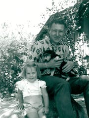 Jennifer Carole and her father, Lyman Smith, pose for a photo in June 1964 in Santa Paula. Carole's father was one of 12 people murdered by a serial killer. An arrest was made Tuesday in a case spanning decades.