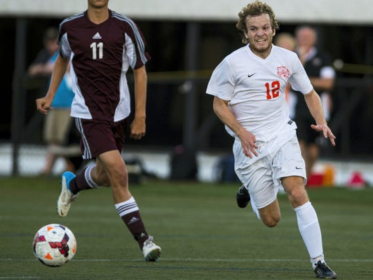 Palmyra's Isaac Albrite chases down a ball during Palmyra's battle with Mechanicsburg on Thursday night.