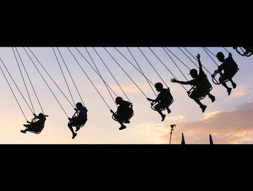 People are seen riding on the midway. This is a photo from day 13 of the Indiana State fair on Wednesday August 13, 2014.