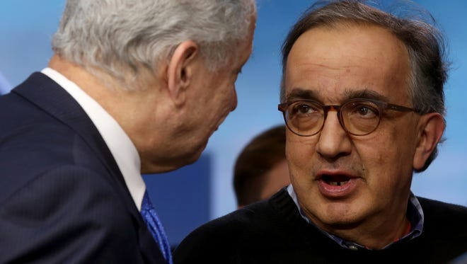 (L to R) National Highway Traffic Safety Administration Administrator Mark R. Rosekind and Sergio Marchionne the CEO of Fiat Chrysler Automobiles talk in front of the 2017 Chrysler Pacifica Hybrid during an impromptu meeting at the 2016 North American International Auto Show at Joe Louis Arena in downtown Detroit on Monday, Jan. 11, 2016. Eric Seals/Detroit Free Press
