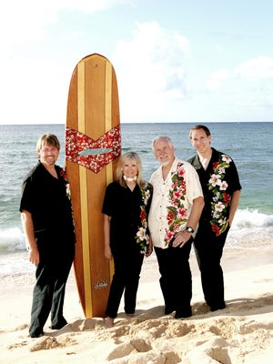 Legendary surf-rock group the Surfaris has become a family affair. Founding guitarist Bob Berryhill, third from left, now leads the band with his sons Deven (left) and Joel (right) and his wife, Gene.