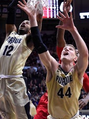Purdue forward Vincent Edwards (12) and center Isaac Haas (44) wait for a rebound against Rutgers in the first half at Mackey Arena.
