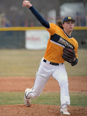 Portage Central freshman Luke Leto fires in a pitch during the Mustangs' home opener against Mattawan.  Leto has been ranked in the top five nationally for Class of 2021.