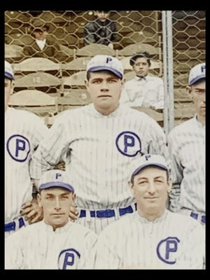A photo, digitally enhanced by Grace K. Harrington, of Babe Ruth, top, with his Providence Grays teammates in 1914.