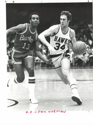 Iowa's Tom Norman drives to the basket against Ohio State. Norman led the conference in scoring as a senior at Freeport and started two years at Iowa.