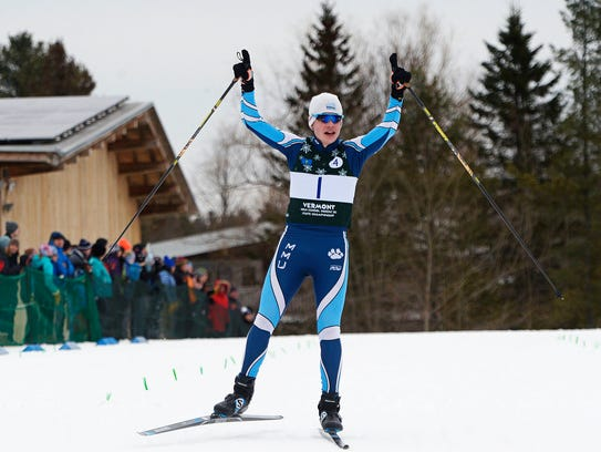 MMU anchor Aidan Burt crosses the finish line as the Cougars won the team relay at the Nordic freestyle state championships at Craftsbury Outdoor Center on Thursday