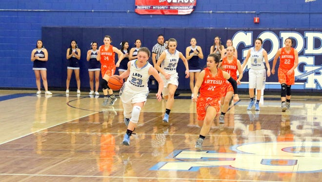 Goddard's Katherine Kolker bolts down the floor against Artesia's Kyrah Gonzales in Friday's 5A state tournament opener.