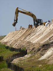 Photo from 2011 shows work on the Herbert Hoover Dike around Lake Okeechobee.