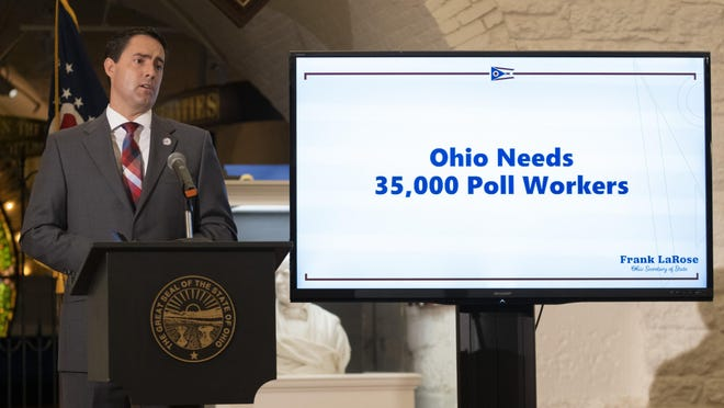 A video screen gives a plea for additional poll workers as Ohio Secretary of State Frank LaRose delivers an update on absentee voting and election security during a press conference in the Ohio Statehouse in Columbus on Wednesday, Aug. 12, 2020.